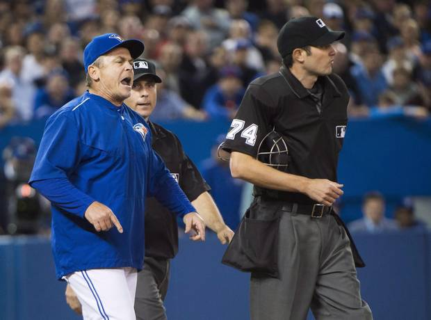 Toronto Blue Jays manager John Gibbons, left, argues with home plate umpire John Tumpane, right, during seventh inning AL baseball action in Toronto on Wednesday, April 27, 2016. Gibbons was ejected from the game.