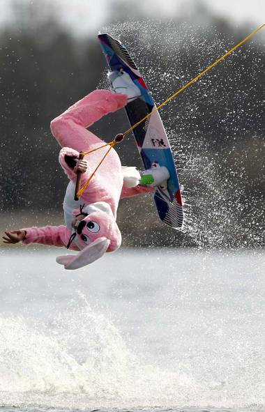 "It was Easter, Muppets, and nothing says ""ressurrection of Jesus Christ"" like a man in a pink bunny suit performing wakeboard manoeuvres in Germany. (Philipp Guelland/AP)"