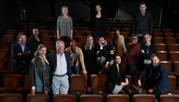Albert Schultz, far left in blue jacket, poses along with the imagiNation project donors, Kevin and Roger Garland, front left and several of the artists who will benefit the donation of $1.25m in new theatre commissions. Project imagiNation will fund 30 to 40 Canadian artists/companies it what is being billed as the