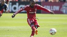 Toronto FC's Jermain Defoe scores from the penalty spot against San Jose Earthquakes during first half MLS action in Toronto on Saturday June 7, 2014. (Chris Young/THE CANADIAN PRESS)
