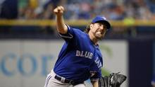 Toronto Blue Jays starting pitcher R.A. Dickey (43) throws a pitch during the first inning against the Tampa Bay Rays at Tropicana Field. (Kim Klement/USA Today Sports)