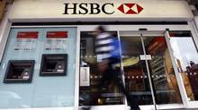 A pedestrian passes a branch of HSBC bank in London, Monday, Feb. 27, 2012. (Kirsty Wigglesworth/Kirsty Wigglesworth/AP)