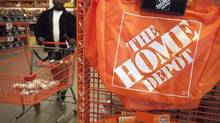 A customer wheels a cart through a Home Depot store in Washington in this file photo. (© Jonathan Ernst / Reuters)