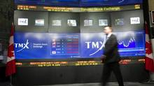 "TMX Broadcast Centre manager Kris Backus walks in front of the centre's display board in Toronto on Monday May 16, 2011. The homegrown group making a $3.6-billion proposal for TMX Group (TSX:X) says its Ðtruly Canadian"" bid wouldn't mean job cuts or a management shakeup and the operator of the Toronto Stock Exchange would remain publicly traded. (Frank Gunn/Frank Gunn/The Canadian Press)"