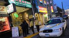 Police investigate a crime scene at a restaurant in Toronto's Chinatown on Dec. 28, 2011. (Kevin Van Paassen/The Globe and Mail/Kevin Van Paassen/The Globe and Mail)