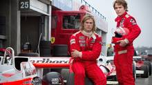 "Chris Hemsworth, left, and Daniel Bruhl in a scene from ""Rush."" Hemsworth plays James Hunt. (Jaap Buitendijk/AP Photo/Universal Pictures)"