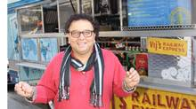 Vikram Vij outside Vij's Railway Express, a mobile restaurant inspired by an Indian rail carriage. Look for the award-winning food truck in Vancouver. (THE CANADIAN PRESS)
