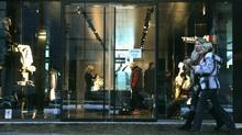 Women walk past a high-end shop in Tallinn (INTS KALNINS)