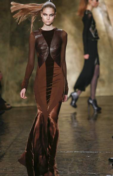"DONNA KARAN Love or hate the holiday, you can't fault Donna Karan for bringing Valentine's Day on early: Monday¹s show was a romantic ode to her late husband, Stephan Weiss. Weiss passed away in 2001, but he still remains very much a part of the Karan DNA (he did help start the business). Striking a balance between her work and his, draping and form were buzzwords here - as was my new favourite portmanteau, something called a ""bodyjacket"" - in gauzy jerseys against haircalf capes and dropped shoulder coats. Where the collection lacked imagination at repetitive times, it made up for in artistry when it came to fabrics. Oxidized crystal beading and neoprene-cashmere? Mind blown. (Bebeto Matthews/AP)"