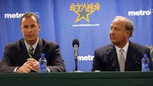 Joe Nieuwendyk, left, addresses the media as Dallas Stars owner Tom Hicks listens during a news conference on June 1. (G.J. McCarthy)