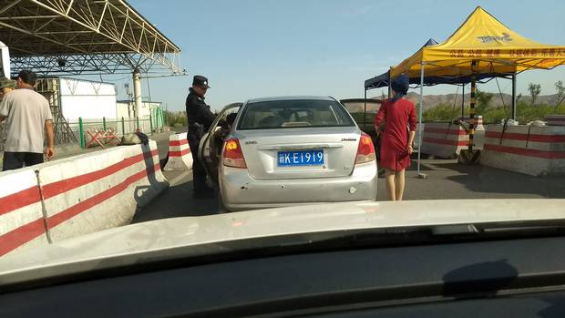 At regular checkpoints on highways across Xinjiang, Uyghur people must submit to vehicle searches and pass through devices that scan identification cards and use facial recognition software to track and manage people's movements.