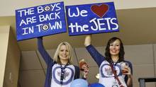 Winnipeg Jets fans cheer as their team plays the Montreal Canadiens during the first period of their NHL hockey game in Winnipeg, Manitoba, October 9, 2011. (FRED GREENSLADE/REUTERS)
