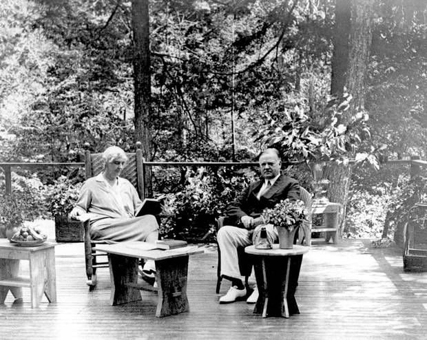1929: Herbert Hoover, right, and Lou Henry Hoover sit o nthe porch at his summer weekend retreat in Virginia.