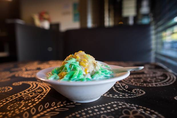 Cendol, a shaved ice dessert with red beans, green jelly and creamed corn.