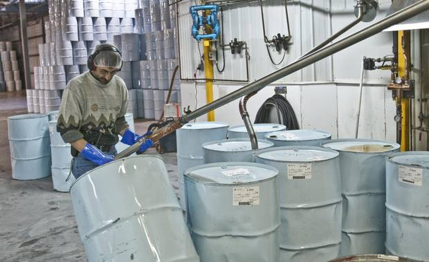 Danny Ayotte fills drums with Maple syrup, prepping it for pasteurization at the International Strategic Reserve in Saint-Antoine-de-Tilly, Que.