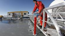Jens Ehn, assistant professor at Centre for Earth Observation Science, gathers ice samples and data at the Sea-ice Environment Research Facility at the University of Manitoba in Winnipeg, March 1, 2013. (John Woods for The Globe and Mail)