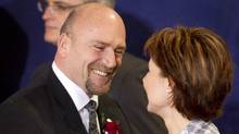 Transportation Minister Blair Lekstrom, shown with Premier Christy Clark, is being pressed by Lower Mainland mayors to impose a vehicle tax to help fund public transit. (John Lehmann/The Globe and Mail/John Lehmann/The Globe and Mail)