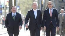 Stephen Poloz, centre, walks with Finance Minister Jim Flaherty, left, and Mark Carney after being named as the next Governor of the Bank of Canada during a news conference , Thursday May 2, 2013 in Ottawa. (Adrian Wyld/THE CANADIAN PRESS)
