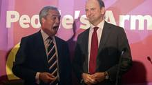 Nigel Farage, leader of the U.K. Independence Party (UKIP), left, reacts as he stands with Douglas Carswell, a Conservative Party member of parliament for Clacton, following a news conference to announce the lawmaker's defection to UKIP, in London, U.K., on Thursday, Aug. 28, 2014. (Chris Ratcliffe/Bloomberg)