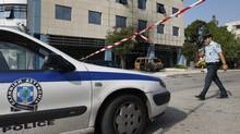 Gunmen ram van into Microsoft's Greek HQ