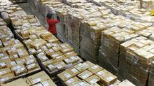 A worker checks a shipment of boxes at the Amazon.com warehouse facility in New Castle, Del. (TIM SHAFFER/TIM SHAFFER/REUTERS)