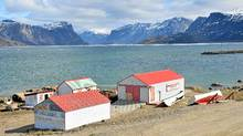 The shoreline of Pangnirtung with the HBC post buildings. Pangnirtung Pass is in the background. (Margo Pfeiff/Margo Pfeiff)