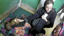 A little over three years after former Canadian freelance photojournalist Amanda Lindhout was kidnapped on the outskirts of Mogadishu, Somalia, she has returned to provide aid to its needy. (Peter Power/The Globe and Mail/Peter Power/The Globe and Mail)