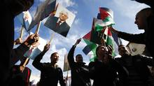 "Palestinians hold placards depicting President Mahmoud Abbas during a rally in support of Abbas' efforts to secure a diplomatic upgrade at the United Nations, in the West Bank city of Ramallah. Abbas will visit New York this week as the Palestinians seek an upgrade of its observer status at the United Nations from that of an ""entity"" to a ""non-member state"". (MARKO DJURICA/REUTERS)"