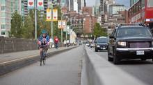 Cyclists make their way over the Burrard Bridge bike lane in Vancouver. (Brett Beadle/Brett Beadle for The Globe and Mail)