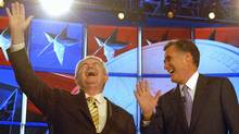 Former House speaker Newt Gingrich laughs alongside former Massachusetts governor Mitt Romney before a Republican presidential debate in Manchester, N.H. on June 13, 2011. (Darren McCollester/Getty Images)