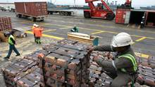 A longshoreman checks a shipment of copper ingots set for export in Valparaiso, Chile. Chile's central bank cut its growth and inflation forecasts for 2012, partly because of falling demand for copper. (Eliseo Fernandez/Reuters/Eliseo Fernandez/Reuters)