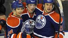 Edmonton Oilers' Jordan Eberle (L) and Ryan Nugent-Hopkins celebrate a goal (DAN RIEDLHUBER/REUTERS)