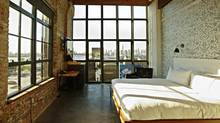 Wythe Hotel rooms are sparse but beautifully furnished, and well stocked with products from local stores.