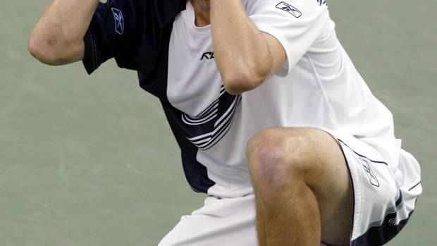 Andy Roddick of the United States celebrates his win over Juan Carlos Ferrero of Spain in the men's final at the 2003 U.S. Open in Flushing, New York, September 7, 2003. Roddick defeated Ferrero 6-3 7-6 6-3. (PETER JONES/REUTERS)