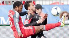 Toronto FC 's Julian de Guzman (left) battles for the ball with DC United's Dwayne DeRosario during first half MLS action in Toronto on Saturday May 5, 2012. (The Canadian Press)