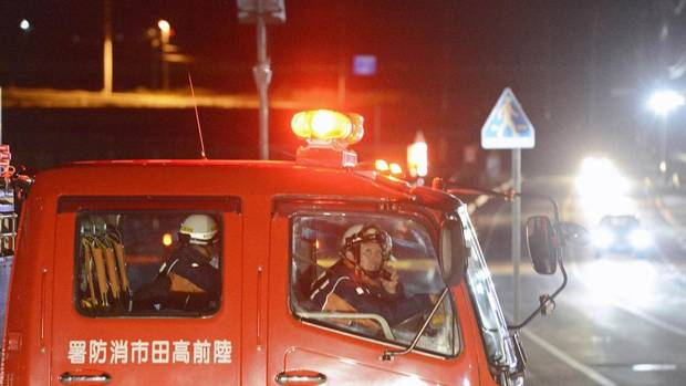 Firefighters broadcast an appeal for residents to evacuate after a strong earthquake hit the area in Rikuzentakata, Iwate prefecture, Dec. 7, 2012. (KYODO /REUTERS)