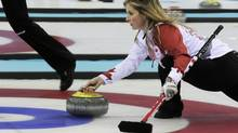 Canada's skip Jennifer Jones delivers the stone in their women's curling round robin game against Sweden at the Sochi 2014 Winter Olympic Games in the Ice Cube Curling Center February 11, 2014. (INTS KALNINS/REUTERS)