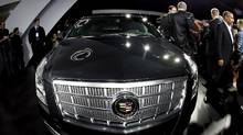 The 2013 Cadillac XTS, one of many new models unveiled at the 2011 LA Auto Show in Los Angeles, California, (LUCY NICHOLSON/Lucy Nicholson/Reuters)