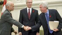 NDP Leader Jack Layton and Bloc leader Gilles Duceppe shake hands as then-Liberal leader Stephane Dion looks on after signing a coalition agreement on Dec. 1, 2008. (Adrian Wyld)