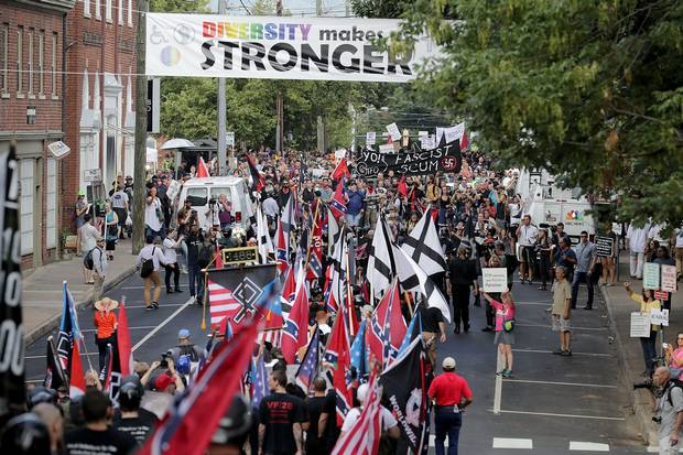 Hundreds of white nationalists and neo-Nazis march down East Market Street toward Lee Park during the