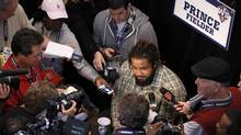 Detroit Tigers first baseman Prince Fielder is surrounded by reporters and cameras after arriving at the ball park to practice for the World Series in San Francisco, October 23, 2012. (DANNY MOLOSHOK/REUTERS)