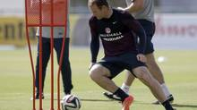 England national soccer team player Wayne Rooney takes part in a squad training session (Matt Dunham/AP)