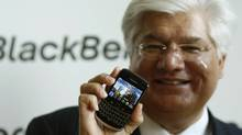 Mike Lazaridis, co-CEO of Research In Motion, poses with the Blackberry Bold 9700 (INA FASSBENDER)