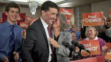 Paul Dewar is embraced by his wife Julia Sneyd as son Nathaniel looks on at the launch of the Ottawa MP's bid for the NDP leadership on Oct. 2, 2011. (Adrian Wyld/Adrian Wyld/The Canadian Press)