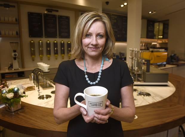 Second Cup CEO Alix Box at a redesigned location in 2014.
