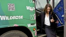 Wildrose party leader Danielle Smith exits her campaign bus to make a policy announcement in Okotoks, Alta., Tuesday, March 27, 2012. Albertans go to the polls on April 23. (Jeff McIntosh/THE CANADIAN PRESS)
