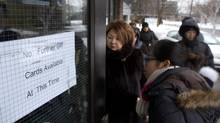 Toronto residents visit the North York East Social Services office on Jan. 2, 2014, to inquire about the availability of gift cards being given to residents who lost food during the ice storm. (FERNANDO MORALES/THE GLOBE AND MAIL)