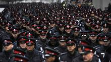 Thousands of police from various police forces make their way down University Avenue as they make their way from 52 Division to the Metro Toronto Convention Centre for funeral services for Sergeant Ryan Russell on January 18 2011. (Fred Lum/Fred Lum/The Globe and Mail)