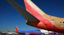 Southwest Airlines planes are seen parked at the gate at the Oakland International Airport (Justin Sullivan/Getty Images)