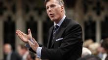 Small Business Minister Maxime Bernier believes the Finance Minister Jim Flaherty overstepped his bounds by asking Manulife Financial to withdraw their discount on five-year mortgages to 2.89 per cent from 3.09. (file photo) (BLAIR GABLE/REUTERS)